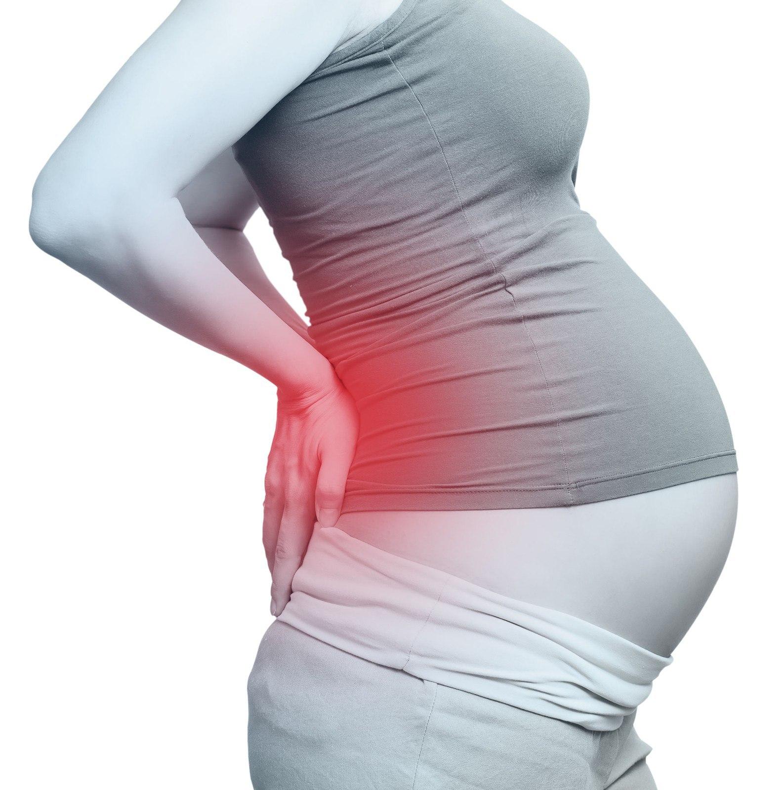 Почему после родов болит поясница